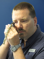 Kelowna's Gold Buyer: Martin Appraising a Bracelet